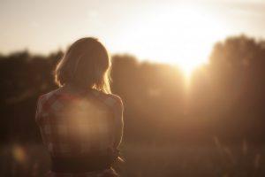 woman standing in sunlight