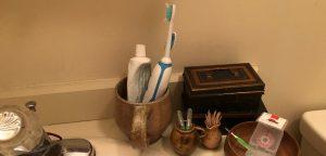 Bathroom sink with oral hygiene tools