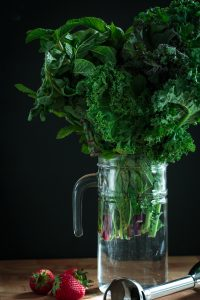 leafy greens with strawberries